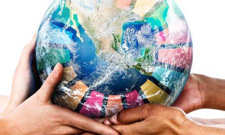 Medium agenda 2030 glob bars av hander ljus bildskapare egdesign